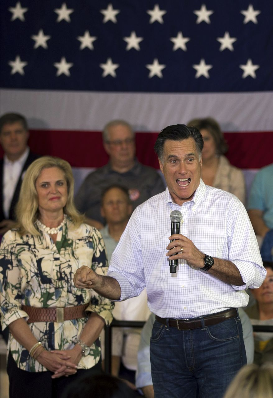 Republican presidential candidate and former Massachusetts Gov. Mitt Romney addresses an audience March 18, 2012, during a campaign stop in Vernon Hills, Ill., as his wife, Ann, looks on. (Associated Press)