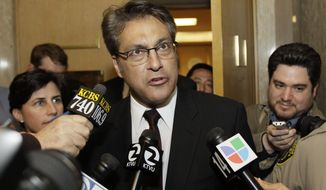 ** FILE ** San Francisco Sheriff Ross Mirkarimi talks to reporters as he leaves Superior Court in San Francisco on Thursday, Jan. 26, 2012. (AP Photo/Eric Risberg, File)