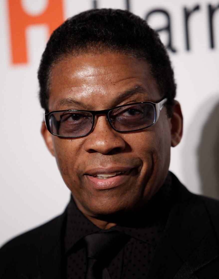 FILE- This Feb. 7, 2009 file photo shows Herbie Hancock arriving at the Clive Davis pre-Grammy party in Beverly Hills, Calif. Ambassador Herbie Hancock believes what the world needs now is a little jazz diplomacy. The renowned jazz pianist's first major initiative since being named a UNESCO Goodwill Ambassador in July is to establish International Jazz Day to be held on April 30 of every year. (AP Photo/Matt Sayles)