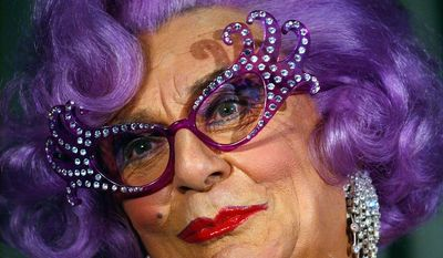 FILE -In this Aug. 25, 2004 file photo Australian actor Barry Humphries, dressed as Dame Edna Everage, appears at a press conference in San Francisco, USA. Dame Edna Everage, the Tony Award-winning drag act known for her purple hair and oversized rhinestone eyeglasses, will soon open her final stage show tour in Australia. (AP Photo/Marcio Jose Sanchez, File)