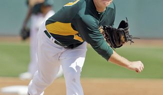 Oakland Athletics' Brad Peacock during a spring training baseball game against the Los Angeles Angels Monday, March 5, 2012, in Phoenix. (AP Photo/Darron Cummings)