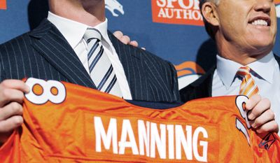 associated press Quarterback Peyton Manning (left) and Broncos vice president John Elway show off Manning's new jersey during a news conference at team headquarters in Englewood, Colo. Manning agreed to a five-year, $96 million contract.