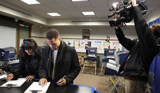 Rep. Jesse L. Jackson Jr. and his wife, Chicago Alderman Sandi Jackson, take advantage of early voting at a polling station in Chicago on Friday, March 9, 2012. (AP Photo/M. Spencer Green)