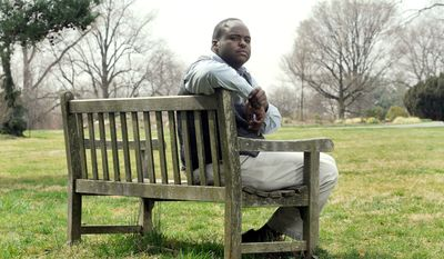 Robert Collins of Baltimore poses for a photo Friday, March 16, 2012, at Cylburn Arboretum in Baltimore. When Collins returned from a leave of absence from his job as a security guard with the Maryland Department of Public Safety and Correctional Services in 2010, he was asked for his Facebook login and password during a reinstatement interview, purportedly so the agency could check for any gang affiliations. (AP Photo/Steve Ruark)