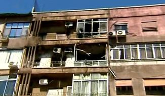 Clashes between Syrian rebels and President Bashar Assad's security forces damaged this apartment building in the Mazzeh neighborhood of Damascus, Syria, on Monday, March 19, 2012. (AP Photo/SANA)
