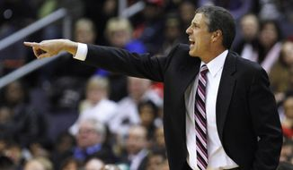 Washington Wizards head coach Randy Wittman directs his team during the first quarter of an NBA game against Golden State at Verizon Center on Monday, March 5, 2012. (AP Photo/Jacquelyn Martin)