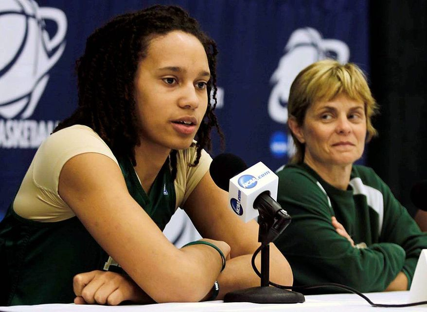 Baylor's Brittney Griner, left, and head coach Kim Mulkey appear during a news conference in Bowling Green, Ohio, on Saturday, March 17, 2012. Baylor is scheduled to play UCSB in an NCAA tournament women's college basketball game on Sunday. (AP Photo/The Blade, Lori King)