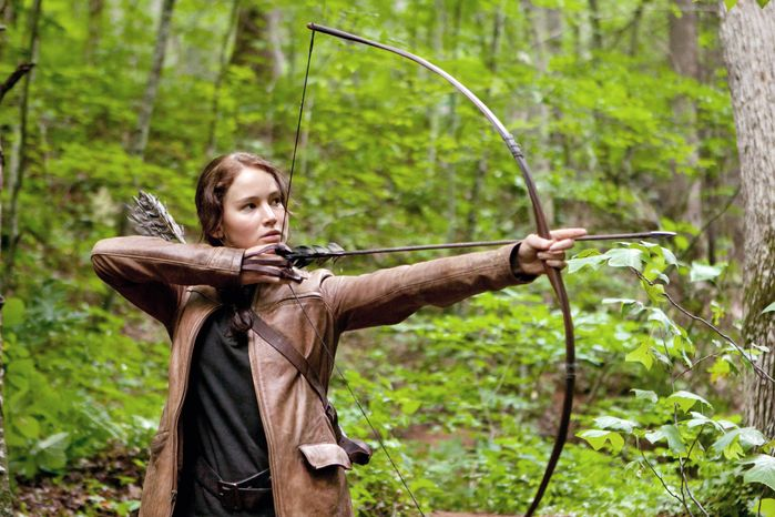 """Jennifer Lawrence portrays Katniss Everdeen, a tough """"tribute"""" from an outlying district who is brought to the Capitol to fight for her life in """"The Hunger Games."""" (Lionsgate via Associated Press)"""