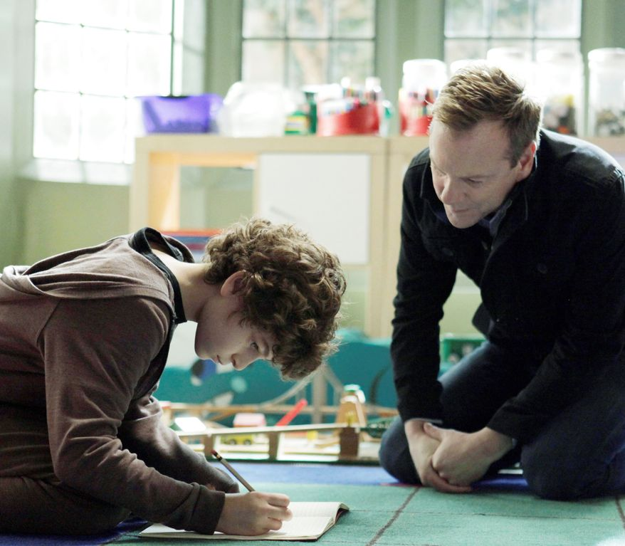 "Kiefer Sutherland is the father of a son played by David Mazouz, who is mute but has an outsized ability with numbers, in the new TV series ""Touch."" It debuts Thursday on Fox. (Fox Television via Associated Press)"