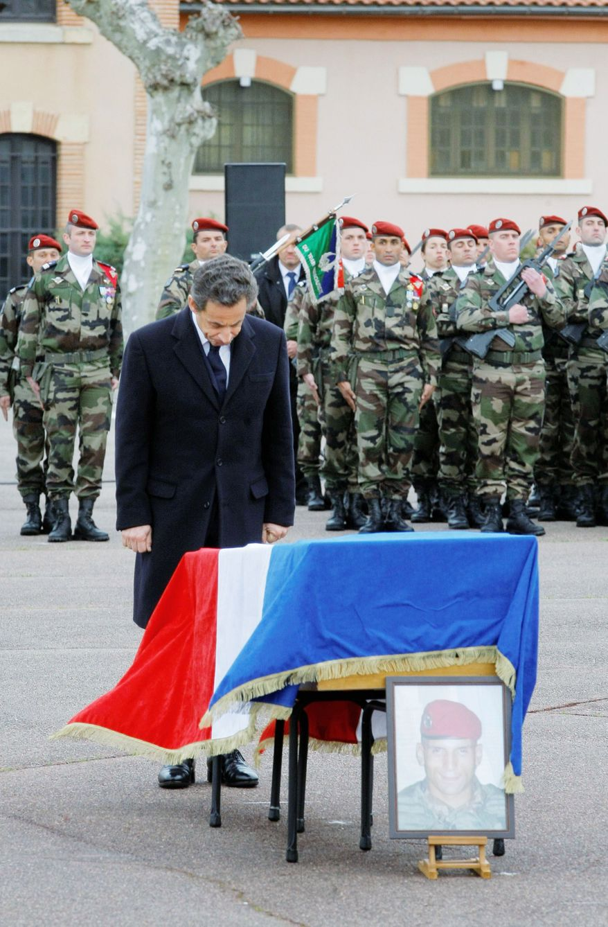 French President Nicolas Sarkozy pays respect during a ceremony Wednesday for three slain paratroopers. Authorities think they were killed by the gunman also thought to be responsible for the deaths of three Jewish children and a rabbi. A 24-year-old Frenchman of Algerian descent is the chief suspect in the seven slayings.