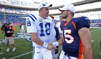 ** FILE ** In this Sept. 26, 2010, file photo, Indianapolis Colts quarterback Peyton Manning (18) greets Denver Broncos quarterback Tim Tebow (15) at an NFL game, in Denver. (AP Photo/Greg Trott)
