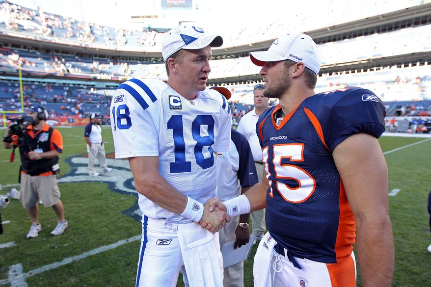 ** FILE ** In this Sept. 26, 2010, file photo, Indianapolis Colts quarterback Peyton Manning (18) greets Denver Broncos quarterback Tim Tebow (15) at an NFL game, in Denver. (AP Photo/Greg Trott)