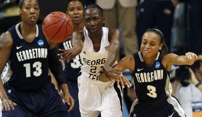 Georgetown's Sydney Wilson and Rubylee Wright (3) guard Georgia Tech's Sydney Wallace, center, during the second half of an NCAA tournament second-round women's college basketball game in Chapel Hill, N.C., Tuesday, March 20, 2012. Georgia Tech won 76-64. (AP Photo/Gerry Broome)