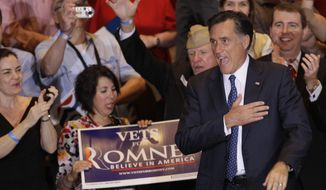 Republican presidential candidate Mitt Romney leaves at an election-night event in Schaumburg, Ill., on Tuesday, March 20, 2012, after winning the Illinois primary. (AP Photo/Nam Y. Huh)