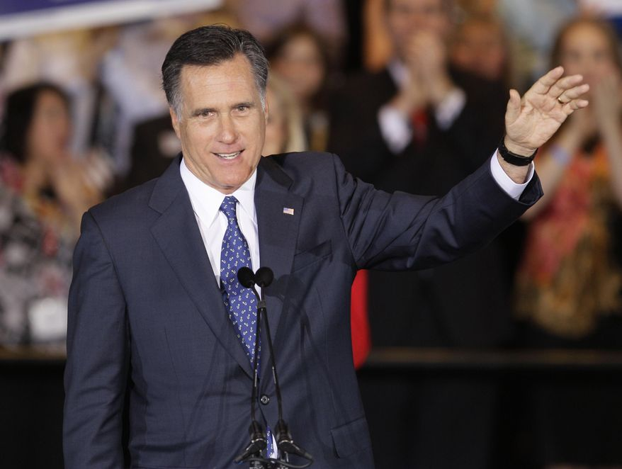 Republican presidential candidate, former Massachusetts Gov. Mitt Romney waves as he speaks at an election night event in Schaumburg, Ill., Tuesday, March 20, 2012. Romney won the Illinois Primary. (AP Photo/Nam Y. Huh)