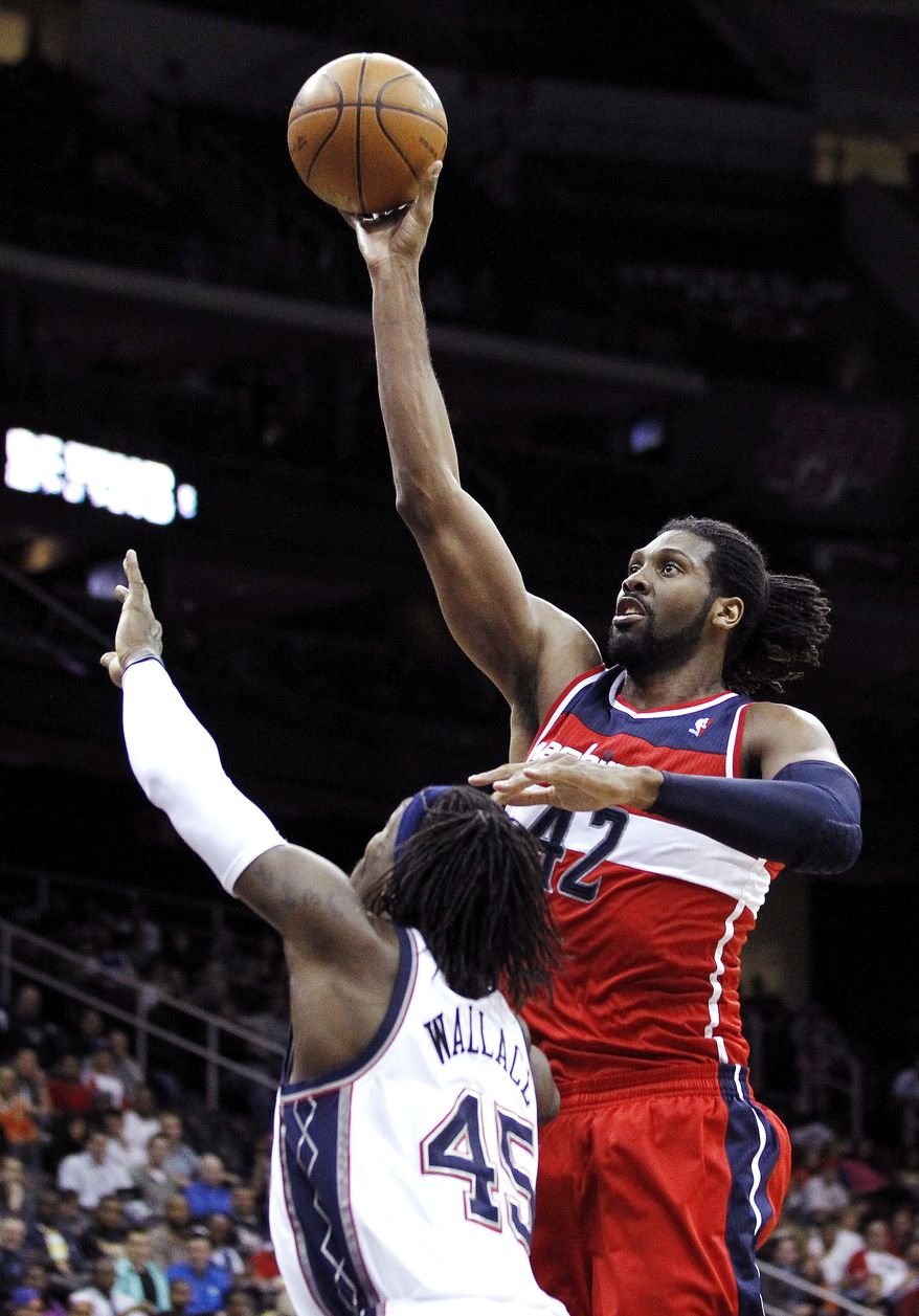 Nene averaged 14.5 points and 7.6 rebounds in 11 games with the Washington Wizards. (AP Photo/Julio Cortez)