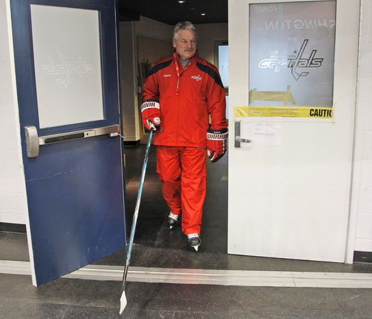 New Washington Capitals hockey head coach Dale Hunter walks out of the locker room for team practice in Arlington, Va., Monday, Nov. 28, 2011. The former Capitals captain takes over for Bruce Boudreau, who was fired. (AP Photo/Pablo Martinez Monsivais)