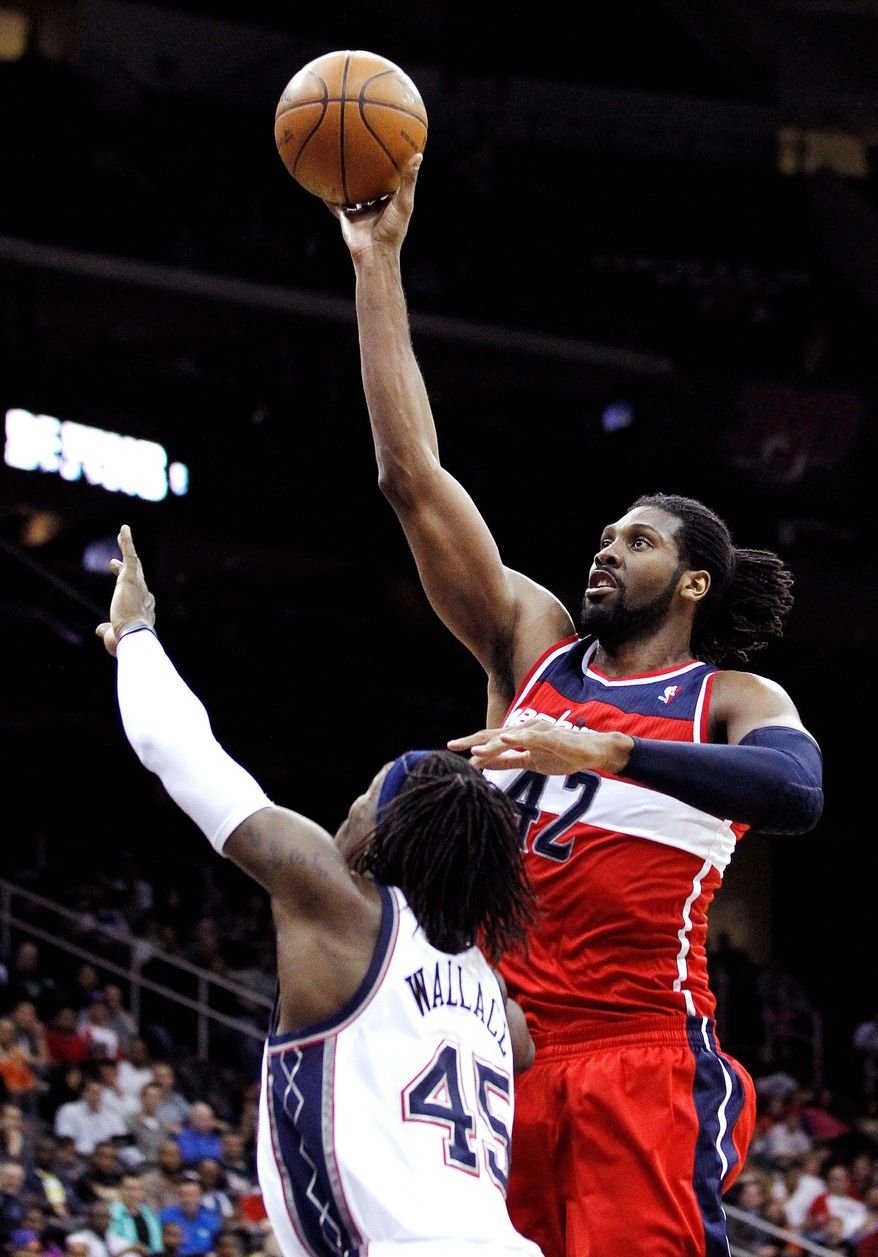 New Wizards center Nene scored 22 points and snared 10 rebounds in a 108-89 win at New Jersey on Wednesday. (Associated Press)