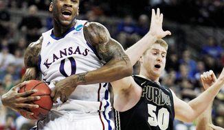 Kansas forward Thomas Robinson has averaged 17.9 points per game and 11.8 rebounds per game this season. (Associated Press)