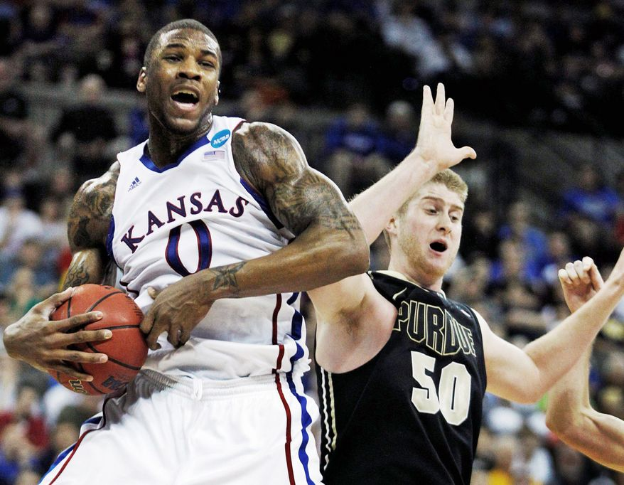 Kansas forward Thomas Robinson has averaged 17.9 points per game and 11.8 rebounds per game this season. (Associated Press)
