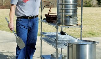 Kevin Flynn shows off some of the brewing equipment he uses to make beer at his home in Caledonia, Wis., earlier this month. (Associated Press)