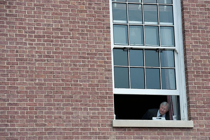 A man in the State House watches the action during the budget demonstration in Annapolis. Inside, the House debates the new budget proposal, which includes higher state taxes. (Barbara L. Salisbury/The Washington Times)