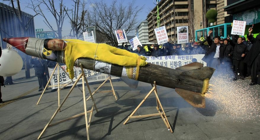 An effigy of North Korean leader Kim Jong-un is put on a mock North Korean missile during an anti-North Korea rally in Seoul on Tuesday, March 20, 2012, to denounce the North's plan to launch a long-range rocket. (Associated Press)