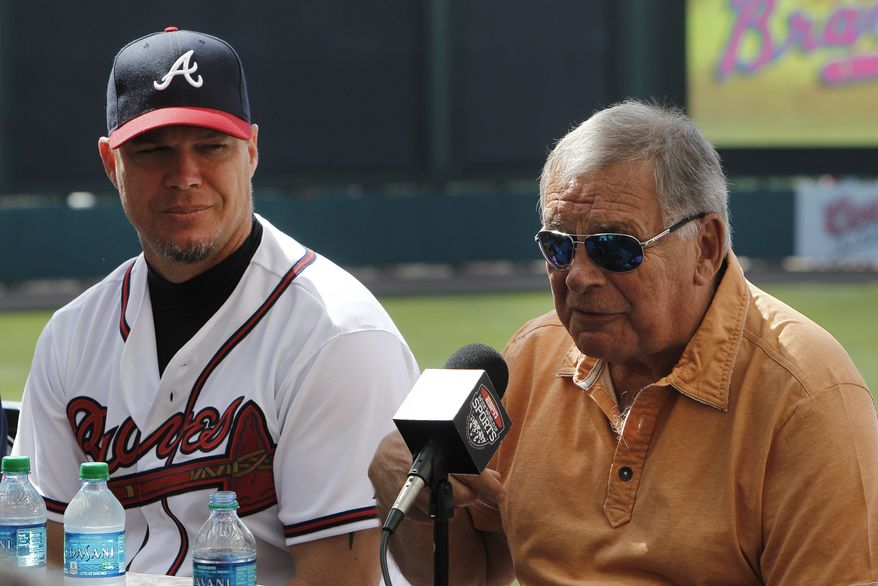 Atlanta Braves third baseman Chipper Jones listens to former manager Bobby Cox during Jones' news conference announcing that he will retire following the 2012 season in Kissimmee, Fla., Thursday, March 22, 2012. Jones has spent his entire career with Atlanta, the same club that drafted him first overall in 1990.(AP Photo/Paul Sancya)