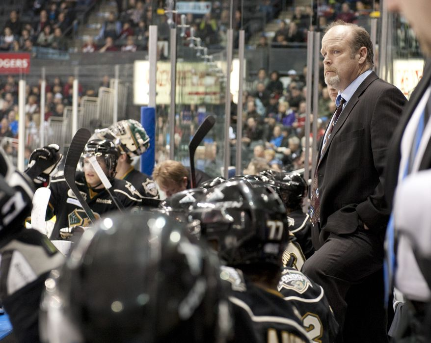 London Knights head coach Mark Hunter watches his team play from the bench during their junior hockey game against the Oshawa Generals at the John Labatt Centre in London, Ontario, Canada on Friday March 2, 2012.  Mark took over the role after his brother, Dale Hunter, became head coach of the Washington Capitals. (Craig Glover/Special to The Washington Times)