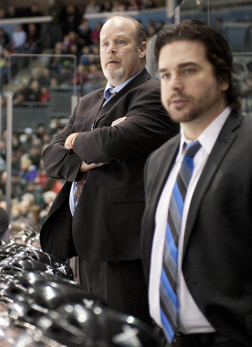 London Knights head coach Mark Hunter, left, along with nephew and assistant coach Dylan Hunter, right, watch their team play from the bench during their junior hockey game against the Oshawa Generals at the John Labatt Centre in London, Ontario, Canada on Friday March 2, 2012.  Mark took over the role after his brother and Dylan's father, Dale Hunter, became head coach of the Washington Capitals. (Craig Glover/Special to The Washington Times)