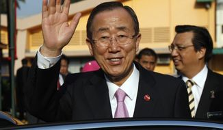 U.N. Secretary-General Ban Ki-moon waves as he leaves the Institute of Respiratory Medicine in Kuala Lumpur, Malaysia, on Thursday, March 22, 2012, after a visit in conjunction with the upcoming World Tuberculosis Day. (AP Photo/Lai Seng Sin)
