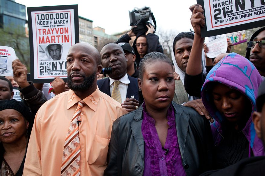 ** FILE ** Trayvon Martin's parents Tracy Martin (left) and Sybrina Fulton (center) are joined by an unidentified woman during the Million Hoodie March in New York City's Union Square on March 21, 2012. A few hundred people marched in memory of Trayvon Martin, a black teenager shot to death by a Hispanic neighborhood watch captain in Florida. The teenager was unarmed and was wearing a hoodie. (Associated Press)