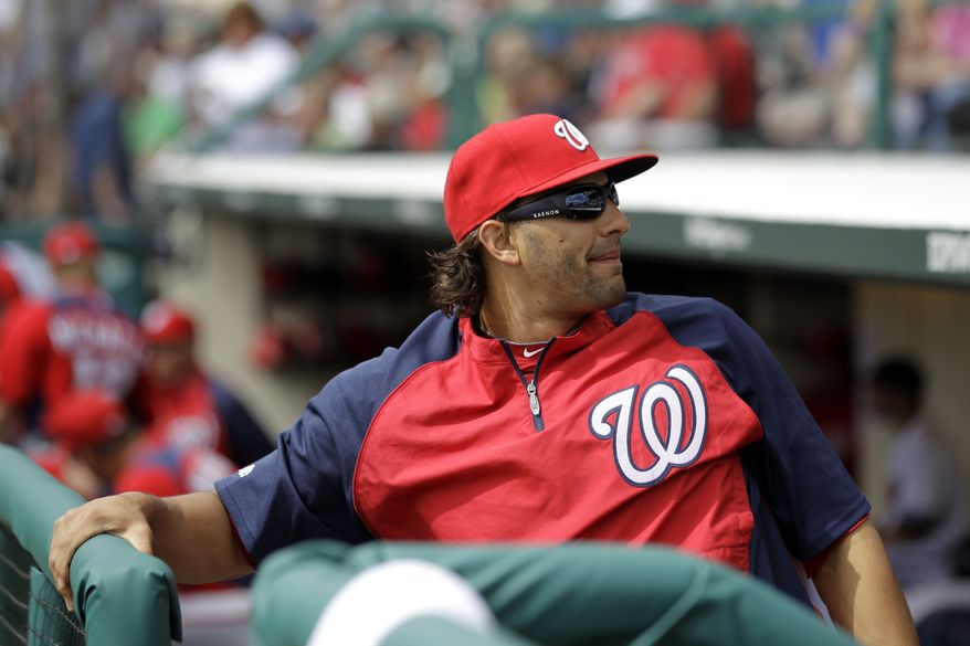 **FILE** Washington Nationals outfielder Michael Morse sits on the bench moments before the start of a spring training baseball game against the Atlanta Braves on March 6, 2012, in Lake Buena Vista, Fla. Morse was scratched off the starting line up because he felt discomfort in his back while warming up. The Nationals won 5-2. (Associated Press)