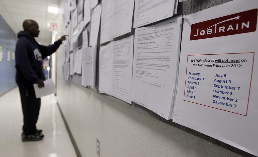 A job seeker checks the bulletin board at a Job Train employment center in Menlo Park, Calif., on Tuesday, Feb. 14, 2012. (AP Photo/Paul Sakuma)