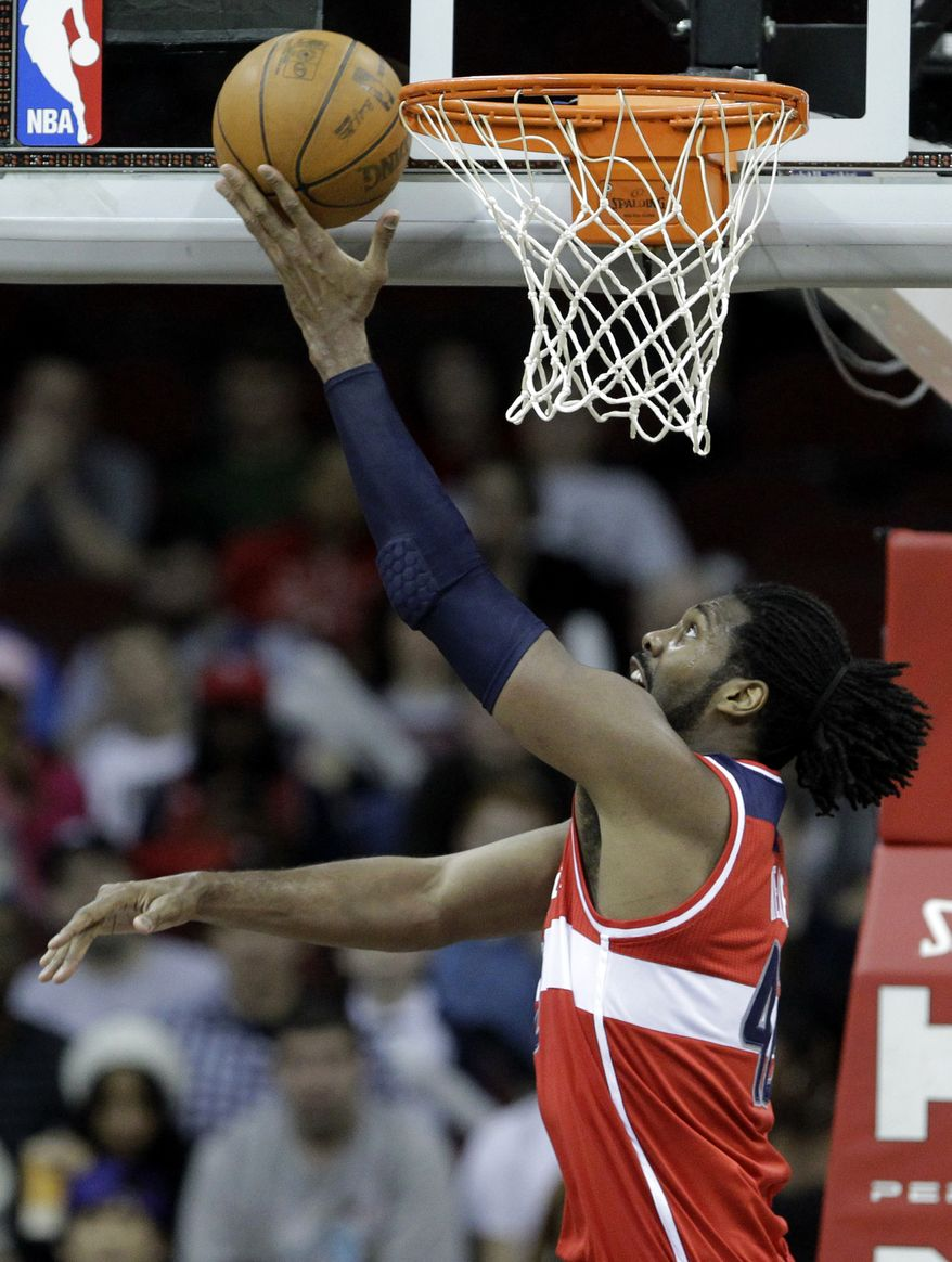 Wizards center Nene averaged 13.7 points and 7.5 rebounds last season. (AP Photo/Julio Cortez)