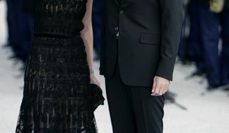 ** FILE ** In this July 13, 2008, file photo, Syrian President Bashar Assad and his wife Asma arrive for a formal dinner after a Mediterranean Summit meeting at the Petit Palais in Paris. (AP Photo/Thibault Camus, File)