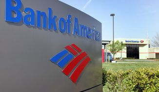 ** FILE ** A Bank of America branch is shown in a Charlotte, N.C. (AP Photo/Chuck Burton)