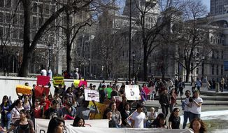 Protesters in support of undocumented youth march March 14, 2012, in Philadelphia from Love Park to the U.S. Immigration and Customs Enforcement office. (Associated Press)