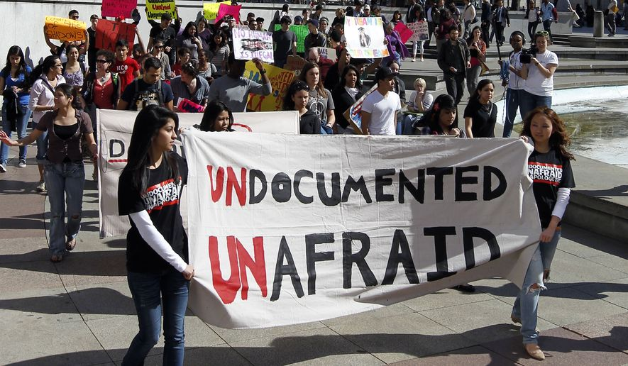 Protesters in support of undocumented youth march March 14, 2012, in Philadelphia from Love Park to the U.S. Immigration and Customs Enforcement office. (Associated Press) **FILE**