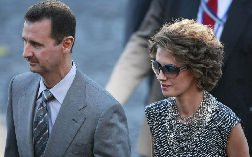 **FILE** Syrian President Bashar Assad arrives July 14, 2008, with his wife, Asma, for the Bastille Day ceremonies in Paris. (Associated Press)