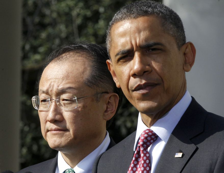 ** FILE ** President Obama stands with Jim Yong Kim, president of Dartmouth College and Mr. Obama's nominee to be the next World Bank president, in the Rose Garden of the White House on Friday, March 23, 2012. (Associated Press)