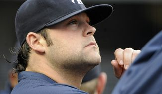 FILE - In this June 13, 2011 photo, New York Yankees pitcher Joba Chamberlain looks on from the dugout during a baseball game against the Cleveland Indians at Yankee Stadium in New York. New York Yankees General manager Brian Cashman said Friday, March 23, 2012, that Chamberlain had surgery Thursday night and will be hospitalized for at least a few days. Cashman says the accident happened Thursday afternoon while Chamberlain and his son were at a Tampa-area spot that has trampoline equipment. The team is not saying whether Chamberlain was using any of the equipment. (AP Photo/Bill Kostroun)