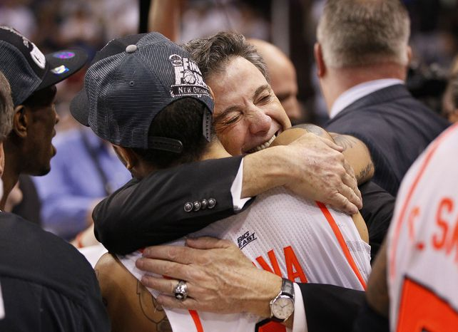 Louisville head coach Rick Pitino (facing camera) hugs Peyton Siva after his team defeated Florida 72-68 in an NCAA tournament West Regional final college basketball game on Saturday, March 24, 2012, in Phoenix. Louisville advances to the Final Four with the win. (AP Photo/Matt York)
