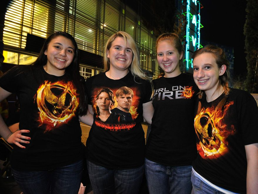 """Hunger Game fans KayLeigh Nava, Jacey Patton, Sarah Martin and Ashley Folkertsma line up to see the midnight shows of """"The Hunger Games,"""" at Rave Motion Pictures Northeast in Hurst, Texas, on Thursday, March 22, 2012. (AP Photo/The Fort Worth Star-Telegram, Max Faulkner)"""