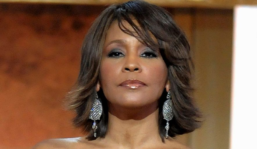 """""""Back in the '80s and '90s, there wasn't a musical act I hadn't interviewed and many of them became friends,"""" write Rusty Humphries. One of those performers was Whitney Houston. (Associated Press)"""
