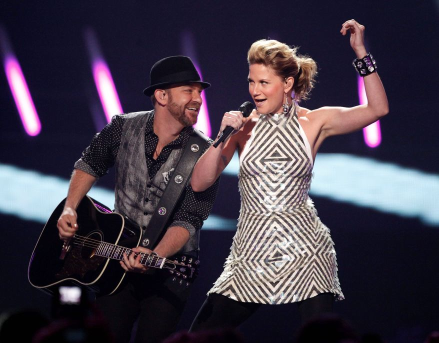 Jennifer Nettles and Kristian Bush (left) of the band Sugarland were about to perform Aug. 13 at the Indiana State Fair when the stage and rigging collapsed, killing seven people and injuring dozens. Miss Nettles has been ordered to give a deposition in the lawsuits that followed. (Associated Press)