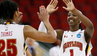 Maryland's Alyssa Thomas and Laurin Mincy had plenty of reason to smile after the Terrapins wiped out an 18-point deficit in their 81-74 win over Texas A&M and advanced to the NCAA women's Final Four. (Associated Press)