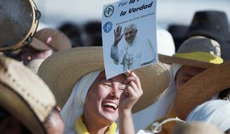 """Pilgrims joyously await Pope Benedict XVI's arrival Sunday to celebrate Mass in Silao, Mexico. """"We pray for him to help us, that there be no more violence in the country,"""" said one participant, Lorena Diaz."""