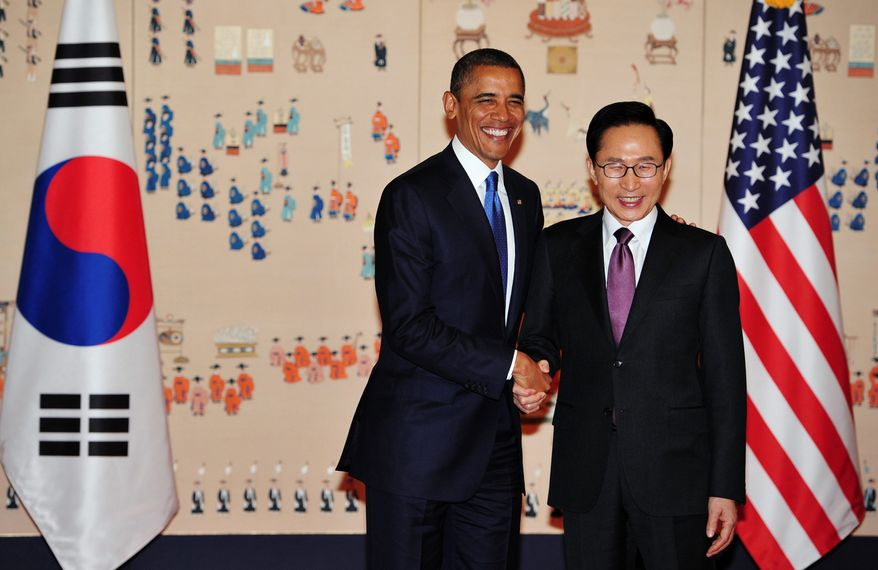 """President Obama. with South Korean President Lee Myung-bak, is in Seoul with other world leaders to discuss measures to safeguard atomic facilities and materials. South Korean Foreign Minister Kim Sung-hwan said he hopes """"concrete steps"""" will be taken during the summit, which opens Monday. (Associated Press)"""