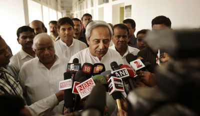 ** FILE ** Orissa state Chief Minister Naveen Patnaik (center) speaks to the media at the state Assembly House in Bhubaneswar, India, on Wednesday, March 21, 2012. (AP Photo/Biswaranjan Rout)